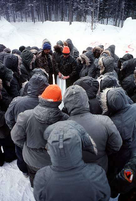 Students of the Navy's Cold Weather Environmental Survival Training are taught various survival techniques by an instructor from the Fleet Aviation Specialized Operational Training Group Atlantic (FASO)