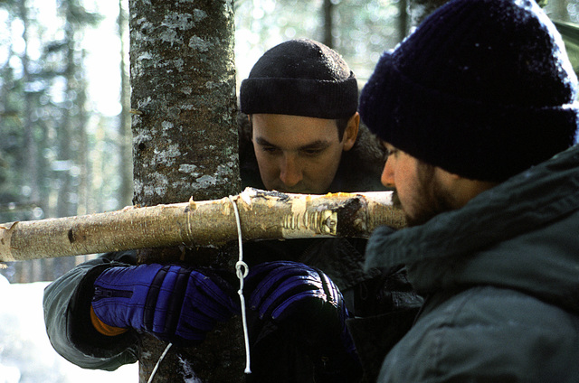 Students of the Navy's Cold Weather Environmental Survival Training use one of the survival techniques taught to them by instructors from the Fleet Aviation Specialized Operational Training Group Atlantic (FASO)