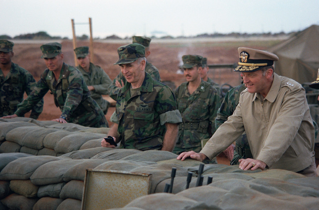 US Army General (GEN) John W. Vessey Jr., chairman of the joint chiefs of staff, inspects a sandbagged bunker with a US Navy flag officer while inspecting US Marine Corps facilities at Beirut International Airport