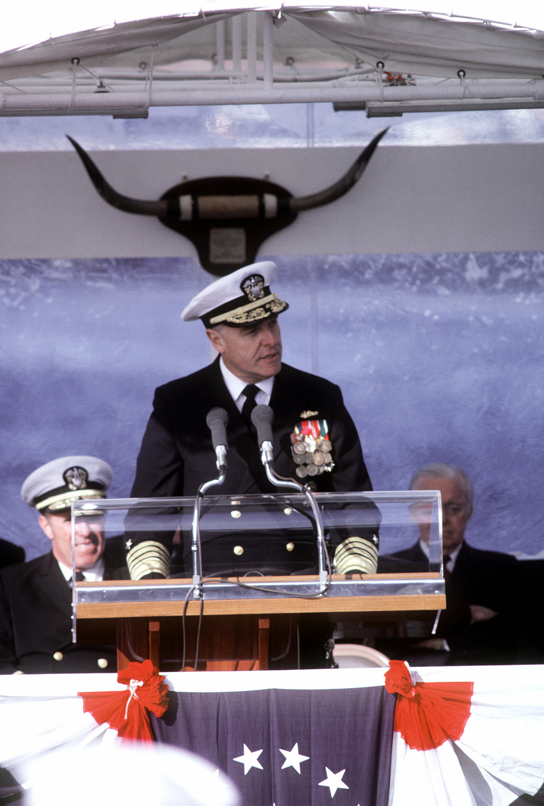 ADM James D. Watkins, chief of naval operations, speaks during the commissioning ceremonies for the nuclear-powered attack submarine USS CITY OF CORPUS CHRISTI (SSN-705). The submarine was built by the Electric Boat Division, General Dynamics Corporation