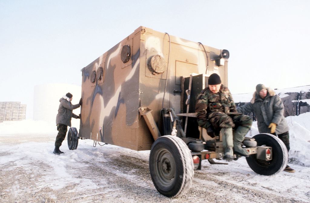 Members of the 104th Tactical Control Flight (TCF) Forward Air Control Post (FACP) move a control van into postion during Exercise Brim Frost '83