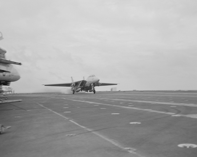 Right front view of an F-14 Tomcat aircraft from Fighter Squadron 213 (VF-213) as it touches down on the flight deck of the nuclear-powered aircraft carrier USS ENTERPRISE (CVN 65). This marks the 200,000th landing of an aircraft aboard the ENTERPRISE