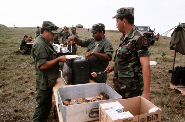 "A meal is served at the field kitchen during the combined United States/Honduran training operation ""AHUAS TARA"" (BIG PINE)"