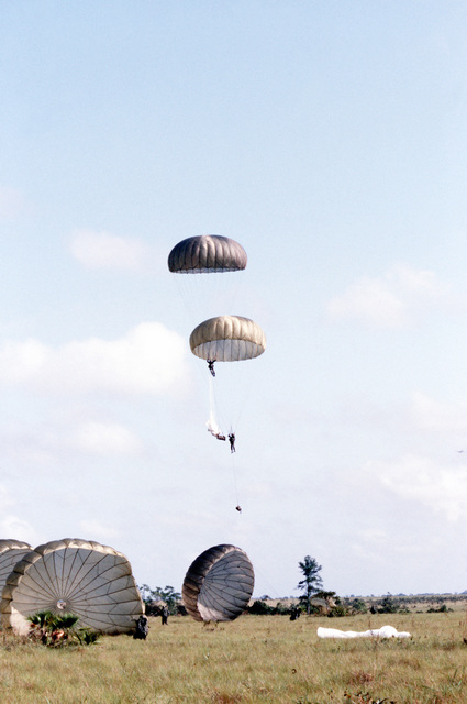 "Honduran Army paratroopers descend into the landing zone during the combined United States/Honduran training operation ""AHUAS TARA"" (BIG PINE)"