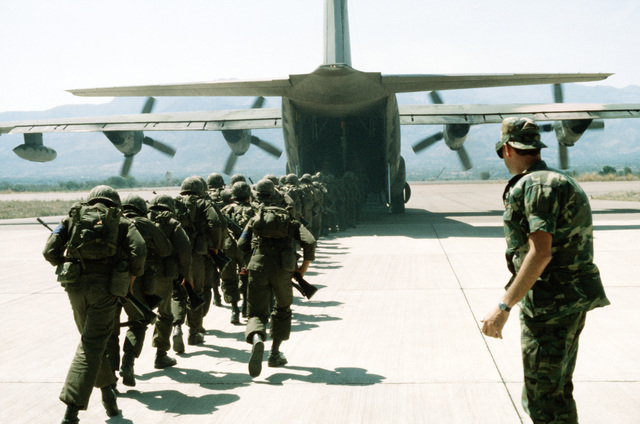 "Members of the Honduran 9th Infantry head for a C-130 Hercules aircraft that will transport them to Puerto Lempira during the combined United States/Honduran training operation ""AHUAS TARA"" (BIG PINE)"