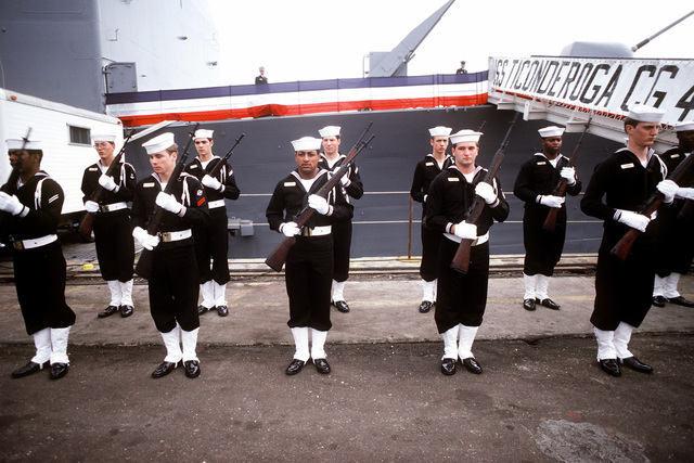 An honor guard drill team performs during commissioning ceremonies for the first Aegis guided missile cruiser USS TICONDEROGA (CG-47) at Ingalls Shipbuilding