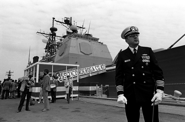 CAPT Roland G. Guilbault, commanding officer of the first Aegis guided missile cruiser USS TICONDEROGA (CG-47), stands on the pier after commissioning ceremonies at Ingalls Shipbuilding