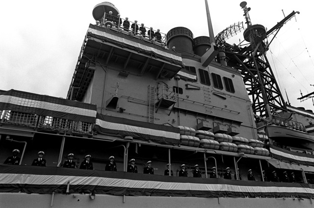 Crewmen man the rail aboard the first Aegis guided missile cruiser USS TICONDEROGA (CG-47) during commissioning ceremonies at Ingalls Shipbuilding