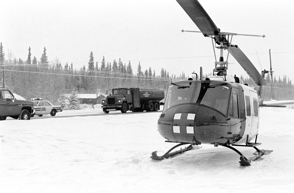 A U.S. Army UH-1 Iroquois helicopter from Fort Wainright, Alaska, rests on the shoulder of the Richardson Highway after being forced to make an emergency landing because of a faulty fuel gauge. No one was injured in the incident