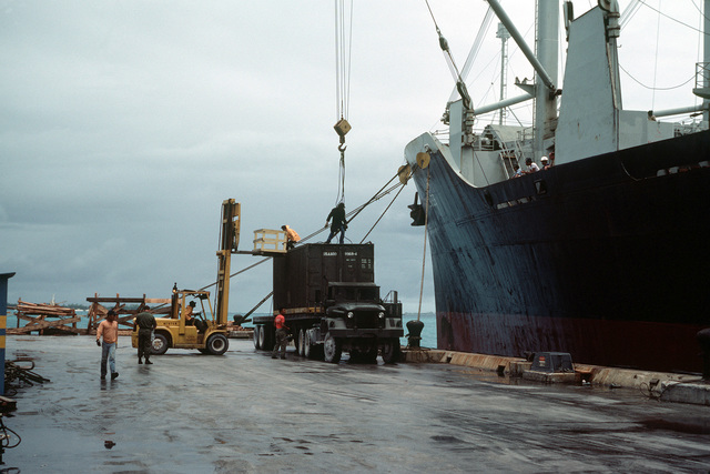 Cargo is offloaded from the civilian-operated forward deployment ship MASON LYKES (AK) moored to the naval support activity pier