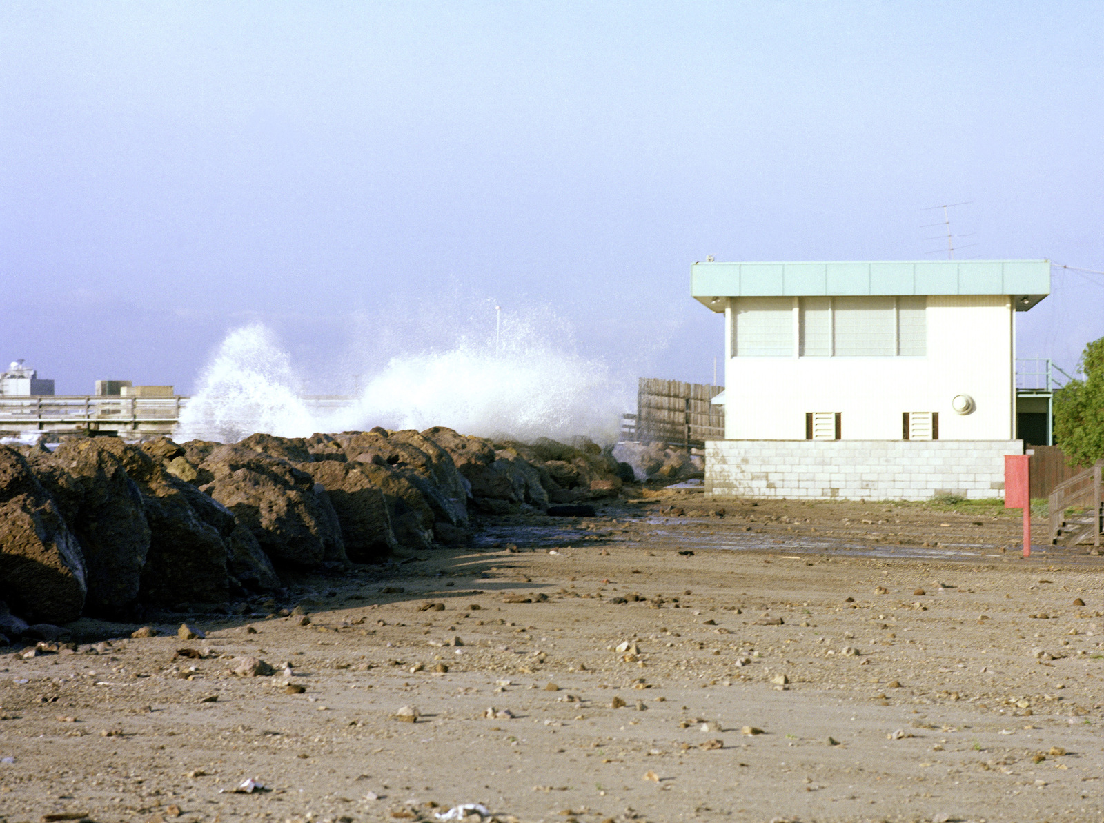 A view of damage caused to the beach area by high tides and