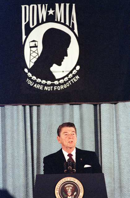President Ronald Reagan addresses a meeting of the National League of Families of American Prisoners and Missing in Southeast Asia. Attendees include relatives of prisoners of war and those missing in action. This special meeting observes the tenth anniversary of the signing of the Paris agreement to end the US involvement in the Vietnam conflict