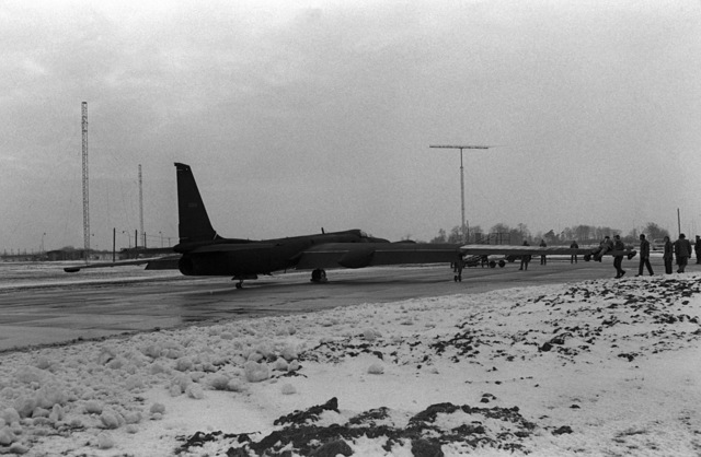 A right rear view of a TR-1 tacitcal reconnaissance aircraft, the first to join the new 95th Reconnaissance Squadron, on the runway after a non-stop flight from Beale Air Force Base, California . While on the runway the aircraft lost a wheel which stabilizes its 103-foot wingspan. A member of the ground crew stabilizes the aircraft by lying on the opposite wing
