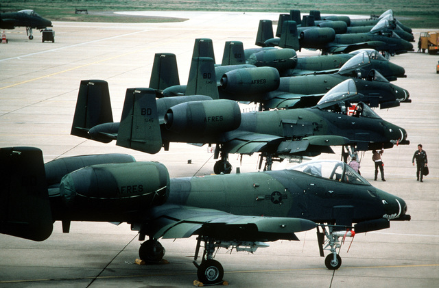 A right side view of a row of a Air Force Reserve A-10 Thunderbolt II aircraft from the 47th Tactical Fighter Squadron parked on the flight line