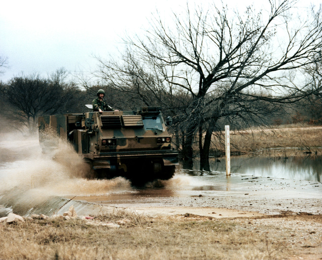 A view of a multiple launch rocket system (MLRS) self-propelled launcher loader (SPLL) in operation