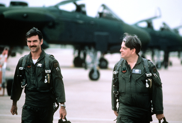 CPT Jerry Prather and CPT Jon Rhynard, both Air Force Reserve A-10 Thunderbolt II aircraft pilots with the 47th Tactical Fighter Squadron, discuss the success of their mission while walking together on the flight line