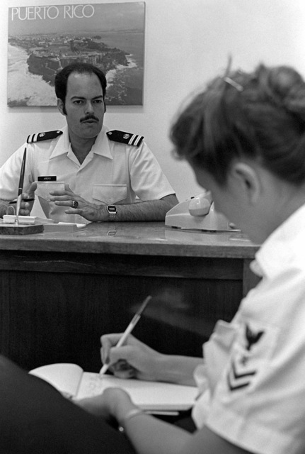 LT Jorge L. Arroyo, lawyer, dictates to a yeoman second class. Arroyo provides legal assistance to U.S. Military and civilian personnel and their families assigned to Rota