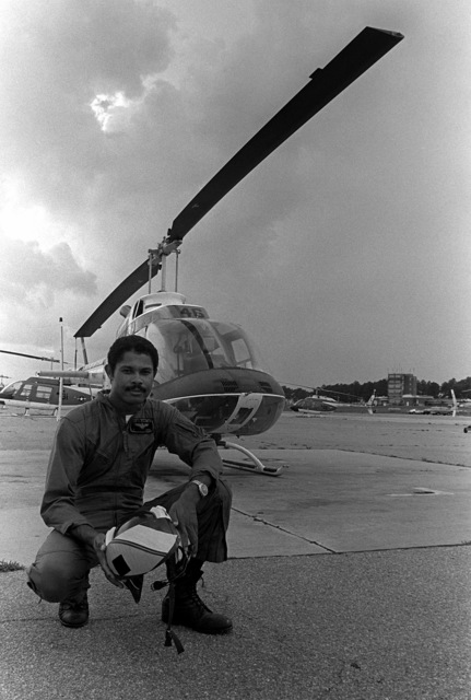 LT Lee O. McKinnon, instructor pilot with Helicopter Training Squadron 8, (HT-8), poses in front of a TH-57A Sea Ranger Helicopter