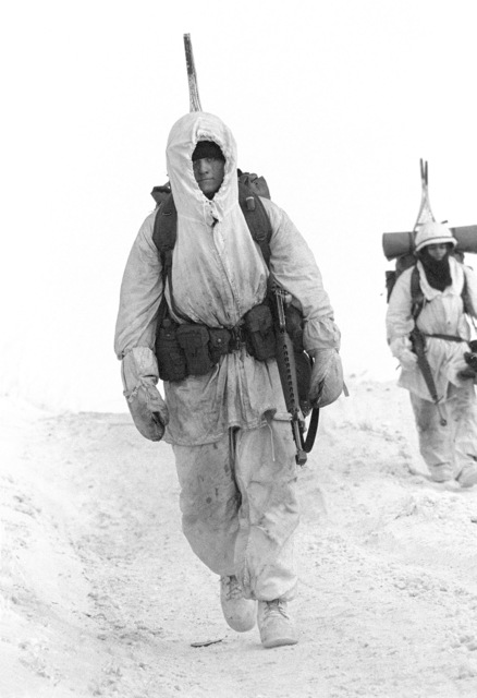Private 2nd Class Hodges of the 4th Battalion, 327th Infantry Regiment, marches through the snow near the base camp during Exercise BRIMFROST '83