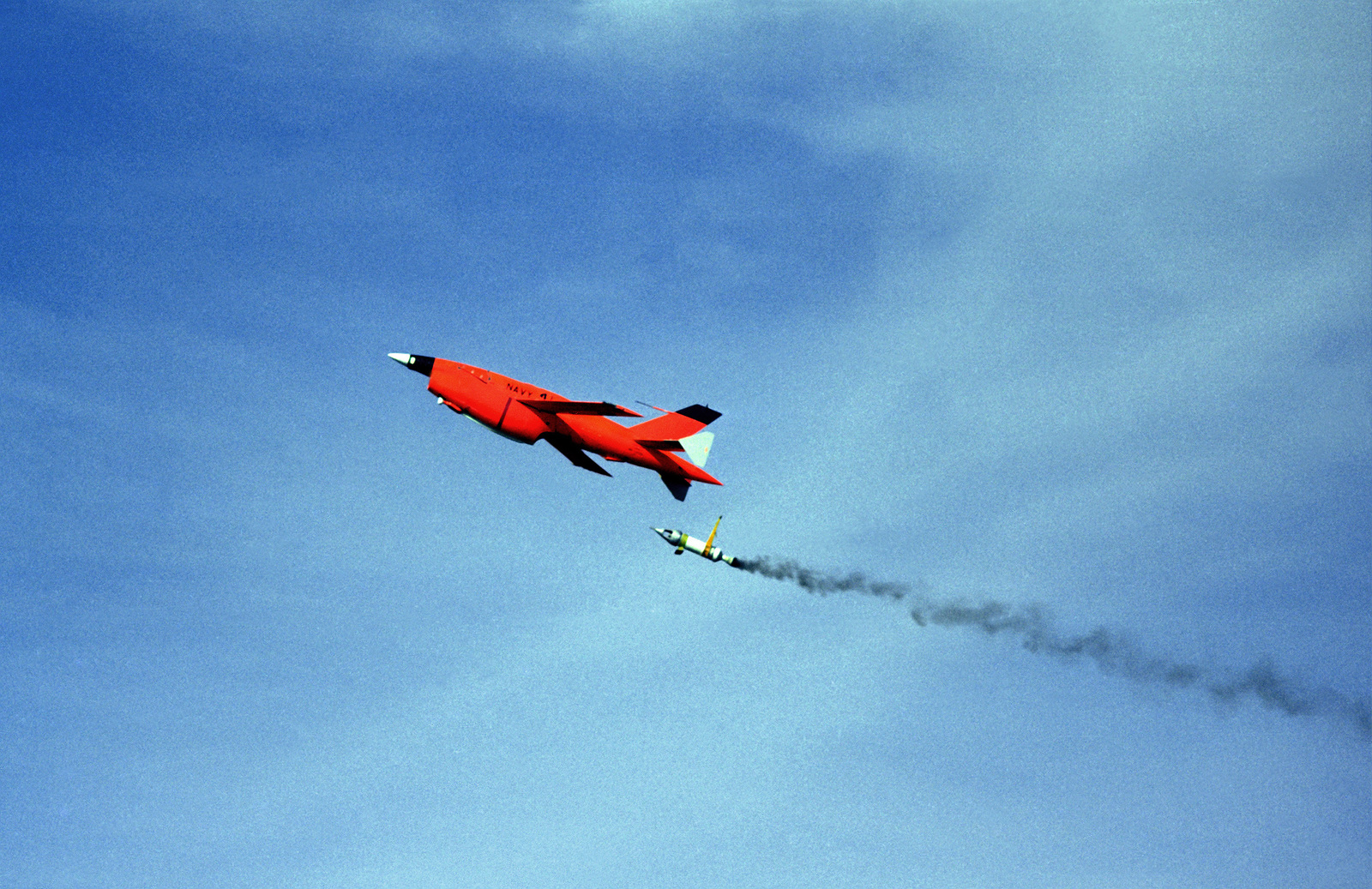 A ground-to-air left side view of a BQM-34S Firebee I remotely-piloted target vehicle moments after lift-off from launch pad #55 at the Pacific Missile Test Center. The jet-assisted take-off bottle (JATO) has just separated from the rear of the drone