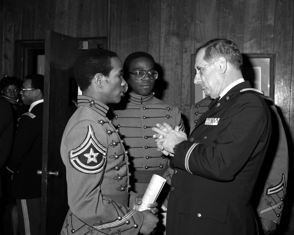 """COL. Robert Berry, head of the law department at the U.S. Military Academy speaks with cadets during Black History """"Dining In."""""""
