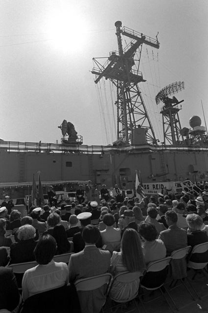 A overall view of guests and distinguished speakers attending commissioning ceremonies for the guided missile frigate USS REID (FFG-30)