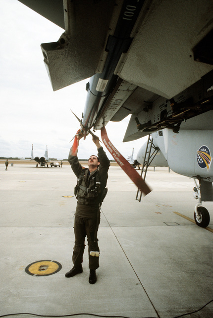 CPT Rick Townsend performs a preflight check on an F-15 Eagle aircraft prior to a mission during exercise Copper Flag