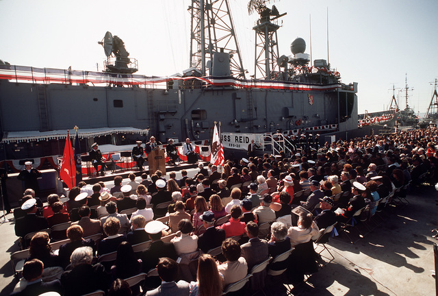 Overall view of guests and distinguished speakers attending commissioning ceremonies for the guided missile frigate USS REID (FFG-30)