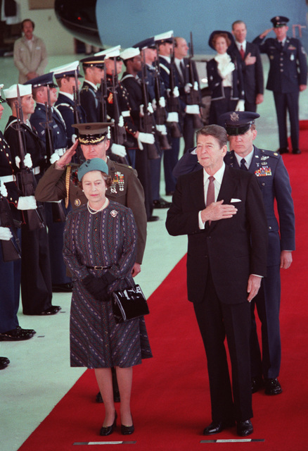 Queen Elizabeth II stands with President Ronald Reagan during a ceremony to honor her visit to the West Coast