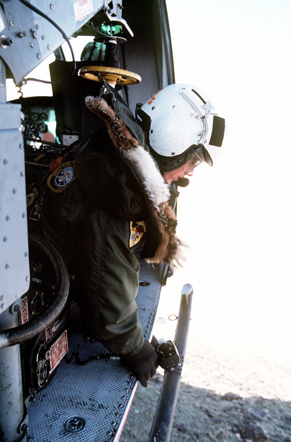 A view of a search and rescue team member aboard a UH-1N Iroquois helicopter during training exercises near Naval Air Station Fallon, Nevada