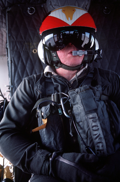 A view of a search and rescue team member aboard a UH-1N Iroquois helicopter during exercises near Naval Air Station Fallon, Nev