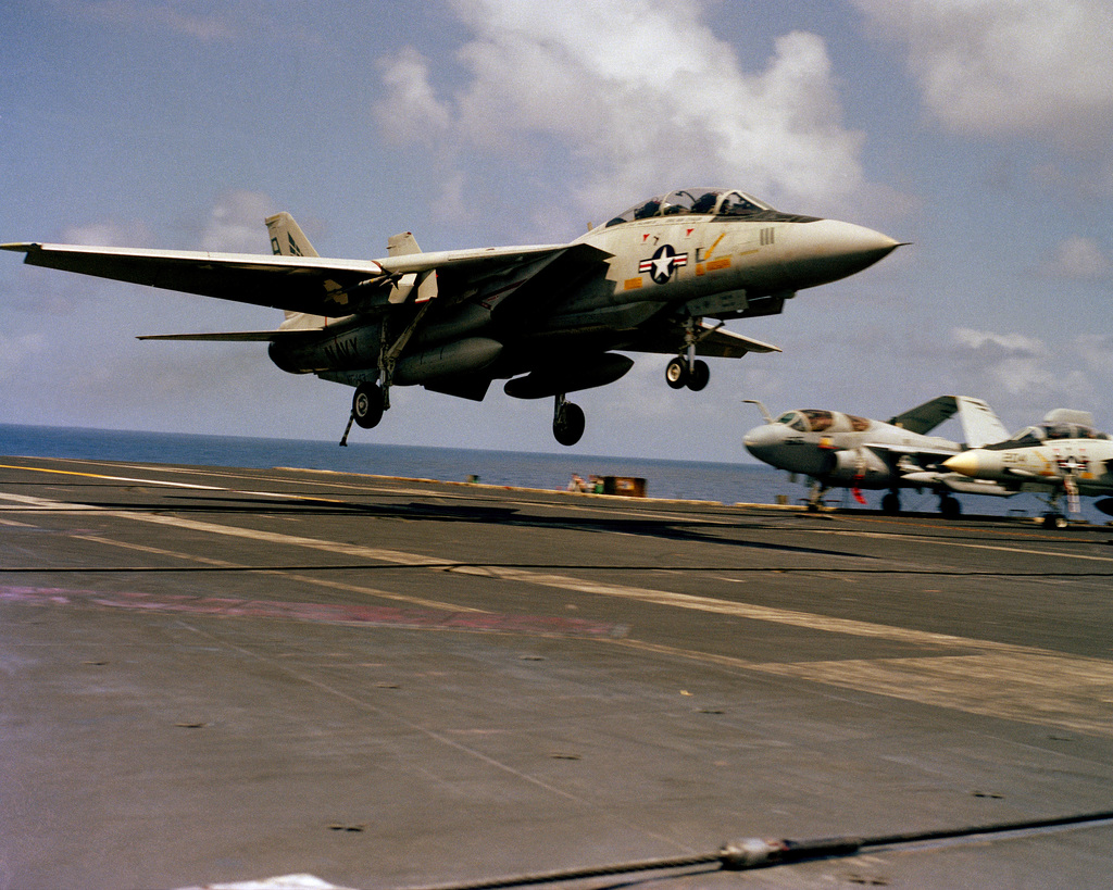 A Fighter Squadron 143 (VF-143) F-14A Tomcat aircraft prepares to land aboard the nuclear-powered aircraft carrier USS DWIGHT D. EISENHOWER (CVN 69)