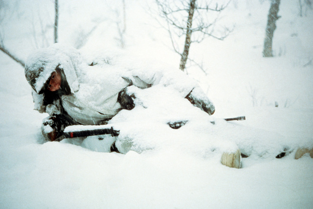 A member of the Co. A, 1ST Bn., 2nd Marine Div., is covered with snow by blizzard that occurred during Exercise Cold Winter '83