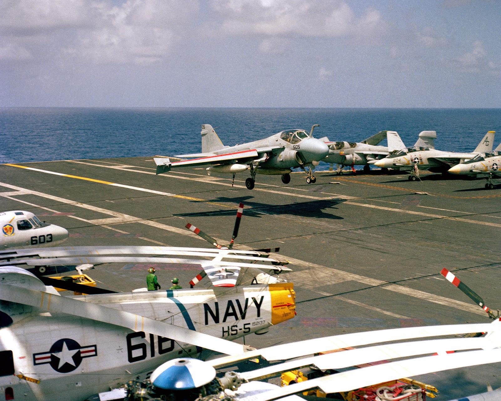 An A-6E Intruder aircraft prepares to land aboard the nuclear-powered aircraft carrier USS DWIGHT D. EISENHOWER (CVN 69)