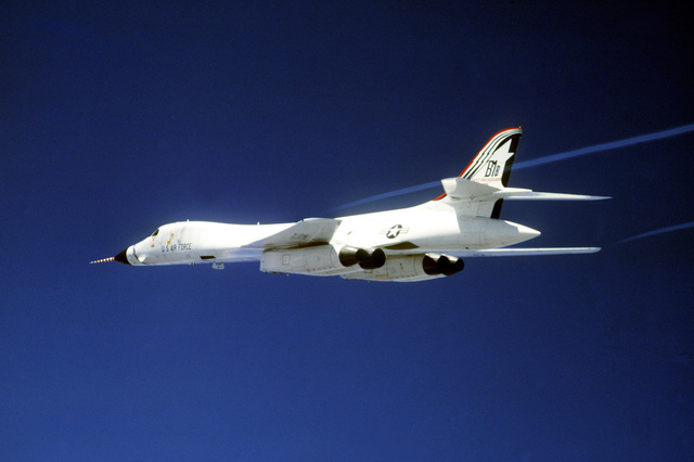 An air-to-air left rear view of a B-1B bomber aircraft from Edwards Air Force Base, California