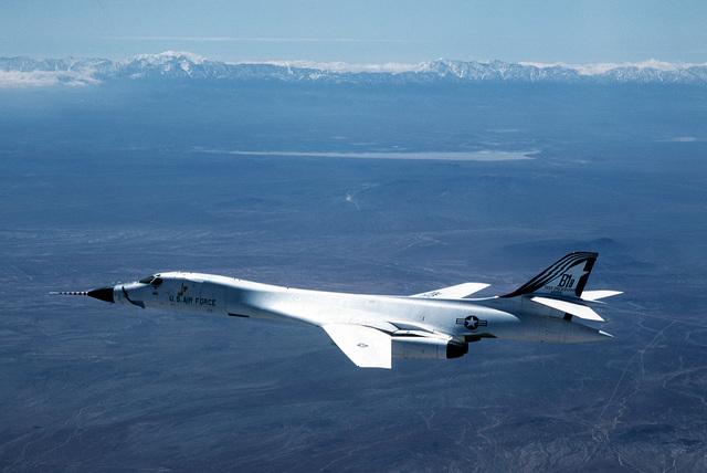 An air-to-air left side view of a B-1B bomber aircraft from Edwards Air Force Base, Calif