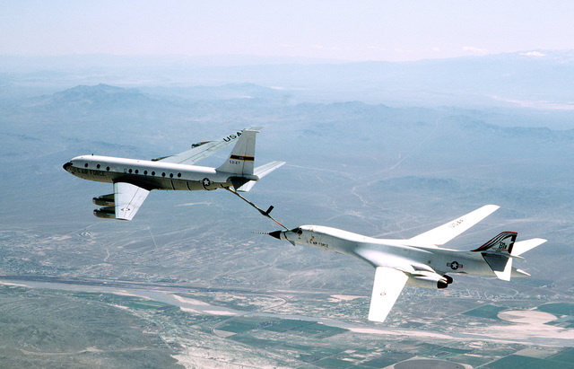 An air-to-air left side view of a KC-135 Stratotanker aircraft refueling a B-1B bomber aircraft from Edwards Air Force Base, California