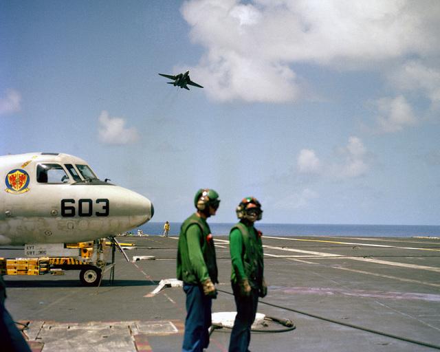An F-14A Tomcat aircraft overflies the nuclear-powered aircraft carrier USS DWIGHT D. EISENHOWER (CVN 69) after being waved off
