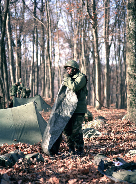 An infantryman inflates an air mattress during bivouac training at the Army Armor Center