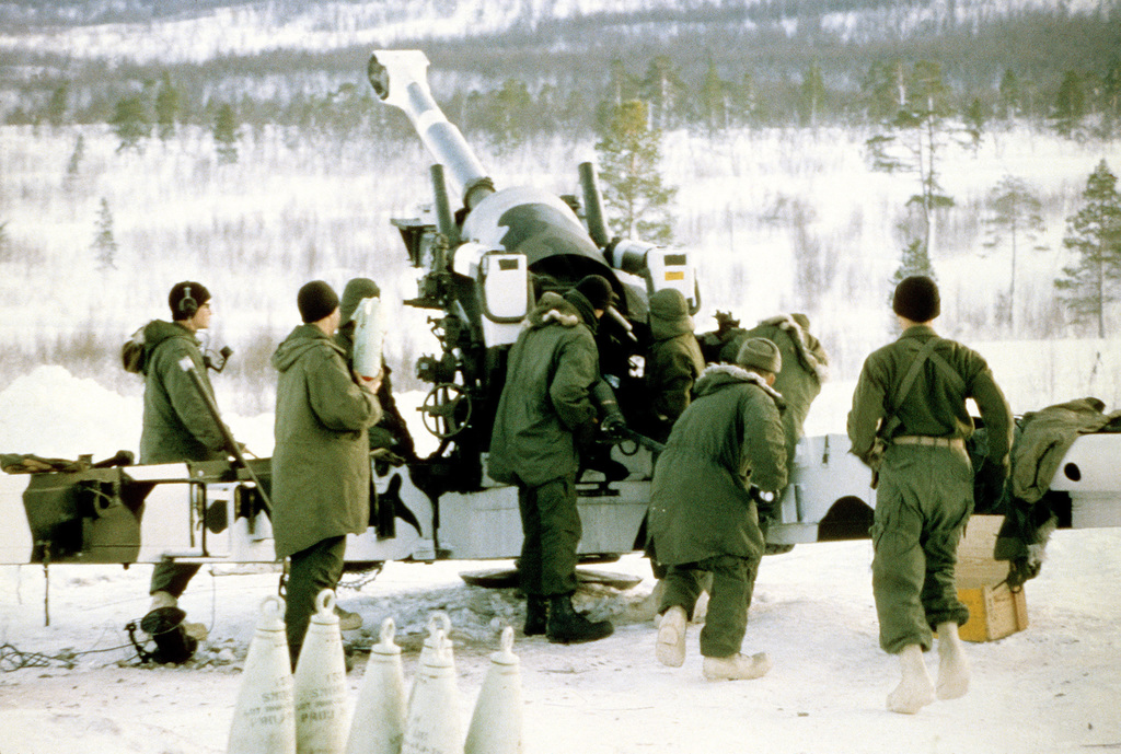 Marines from the 3rd Bn., 10th Marines, 2nd Marine Div., load an M-198 155mm medium towed Howitzer during live-fire training conducted as part of Exercise Cold Winter '83