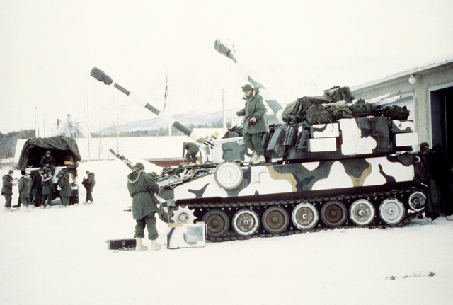 Marines of the 2nd Tank Battalion perform maintenance on two M-109 self-propelled howitzers during Exercise Cold Winter '83