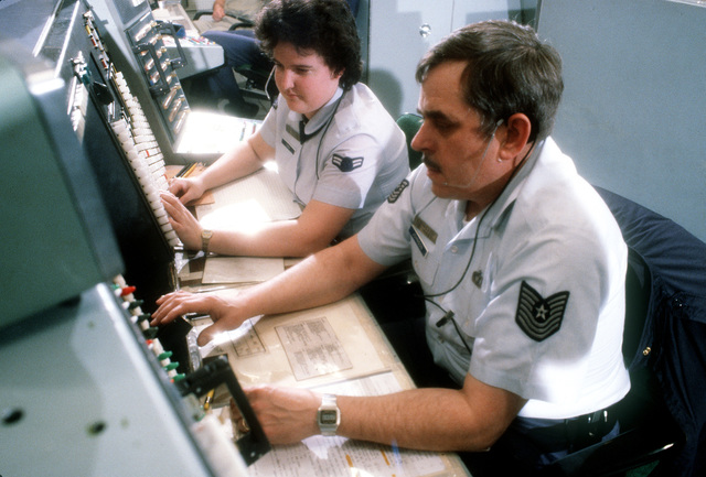 MASTER SGT. David D. Johnson and AIRMAN Patricia A. Downey, of the 678th Air Defense Group, monitor aircraft movement on a defense weapons console during exercise Copper Flag