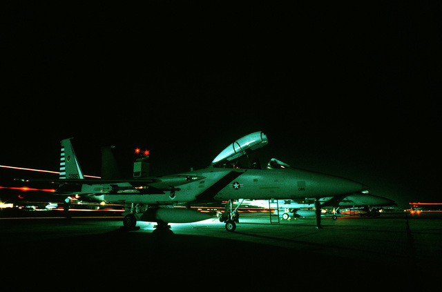 Nighttime view of an F-15 Eagle aircraft, assigned to the 48th Fighter Interceptor Squadron, on the flight line during Exercise Copper Flag
