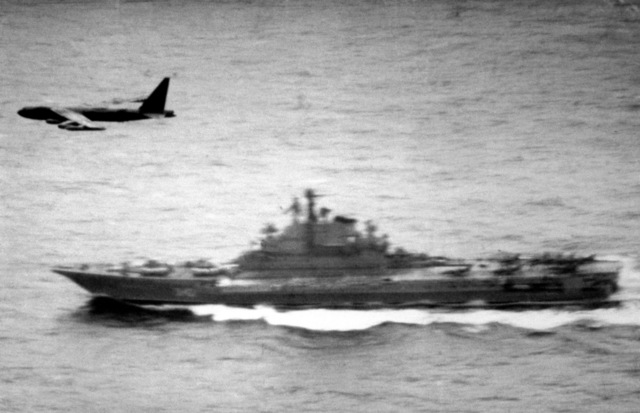 A Strategic Air Command B-52D Stratofortress aircraft overflies the Soviet aircraft carrier Kiev while on a routine maritime reconnaissance mission over international waters