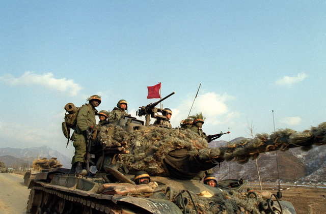 Members of the 1ST Battalion, 19th Infantry, 25th Infantry Division, aboard a South Korean army M-47 tank, prepare for a confrontation with the Blue Forces during the joint South Korean/US training Exercise TEAM SPIRIT '83