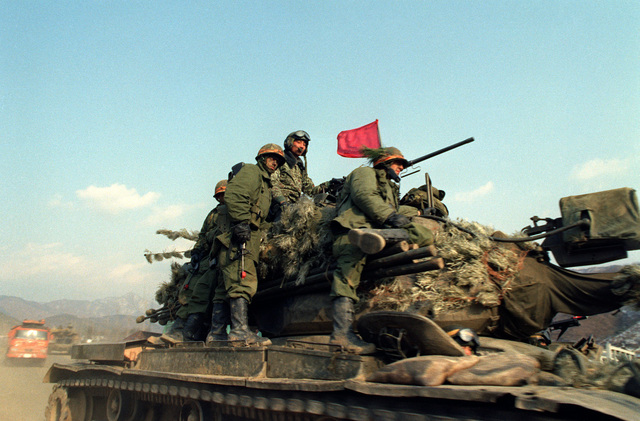 Members of the 1ST Battalion, 19th Infantry, 25th Infantry Division, aboard a South Korean army M-47 tank, prepare to confront Blue Forces during the joint South Korean/US training Exercise TEAM SPIRIT '83