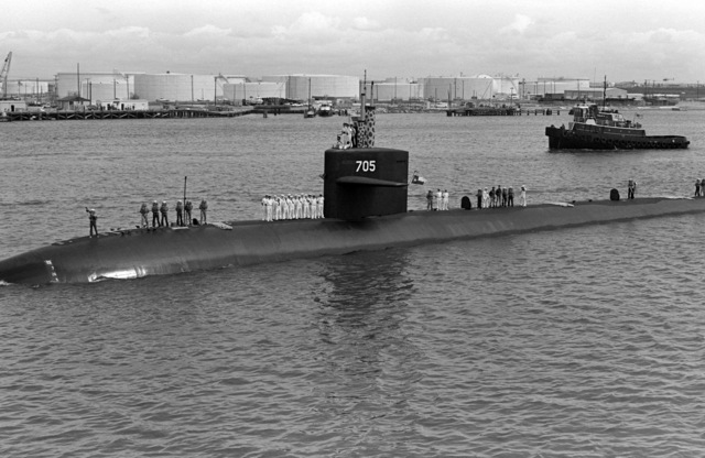 A port bow view of the nuclear-powered attack submarine USS CITY OF CORPUS CHRISTI (SSN 705) underway in Corpus Christi Bay during its first visit to its namesake city