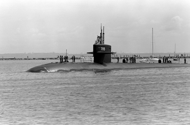 A starboard view of the nuclear-powered attack submarine USS CITY OF CORPUS CHRISTI (SSN 705) underway through Corpus Christi Bay during its first visit to its namesake city