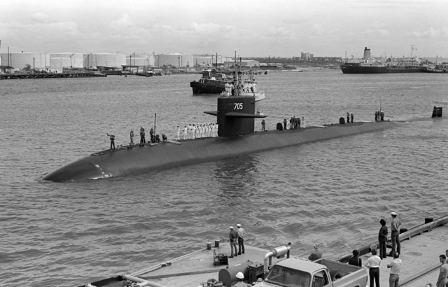The nuclear-powered attack submarine USS CITY OF CORPUS CHRISTI (SSN 705) approaches the pier during its first visit to its namesake city