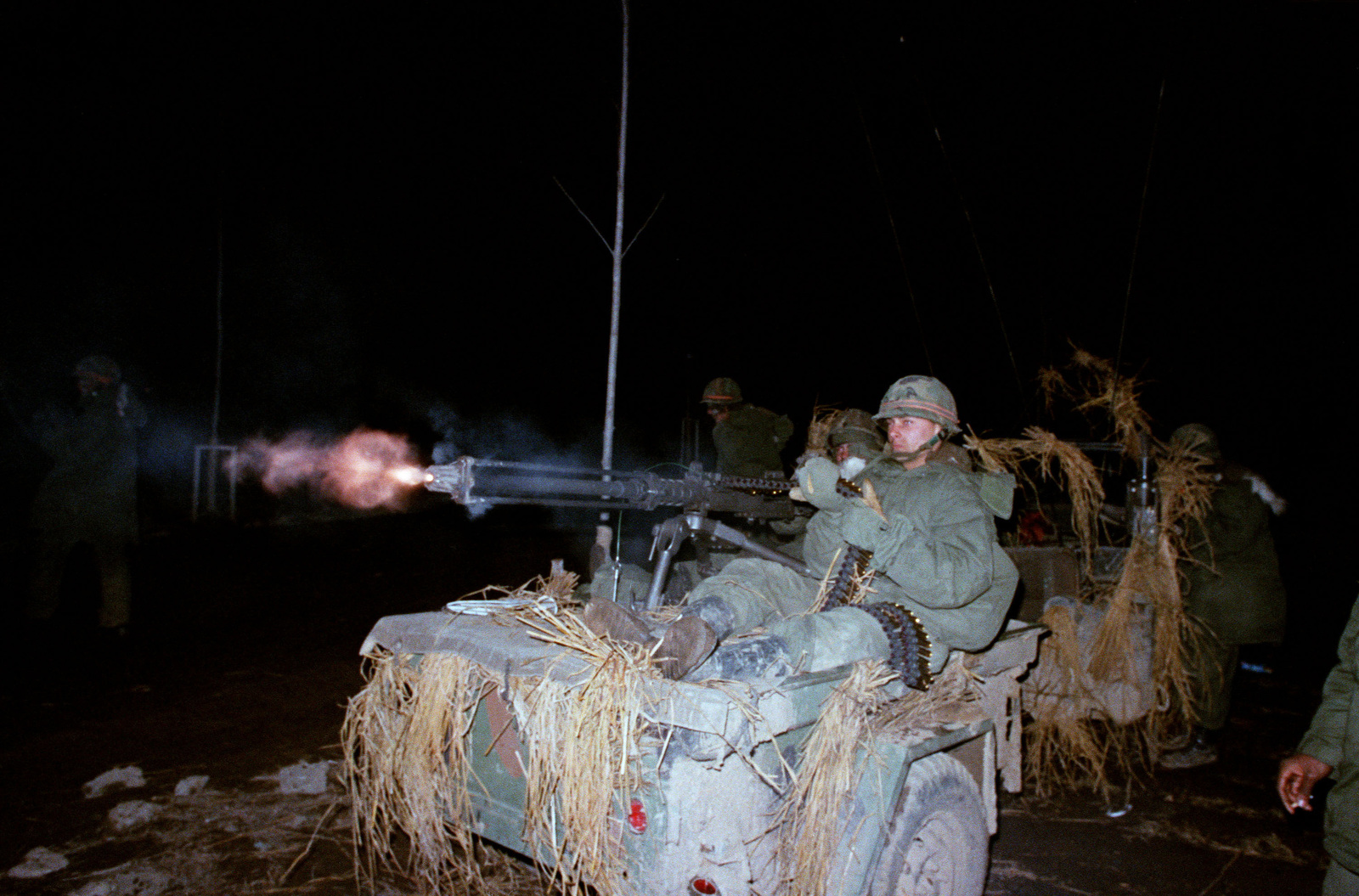 Members of Company B, 1ST Battalion, 5th Infantry Division (Orange Forces), fire .50-caliber machine guns against attacking Blue Forces during the joint Korean/United States training exercise TEAM SPIRIT '83